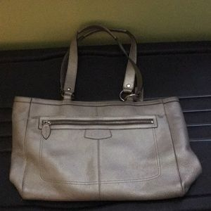 Silver Coach bag with small checkbook. 🙂